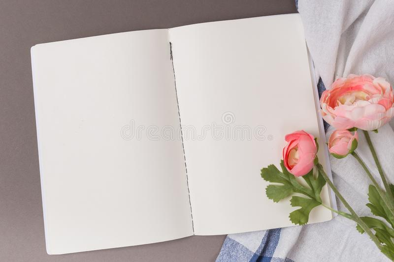 Empty sheets of open notebook on a blue background. And Towel Clean space stock photos