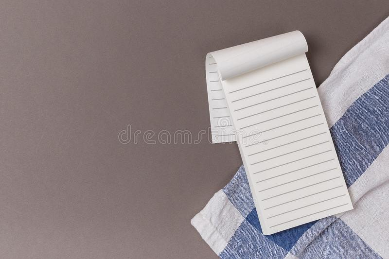 Empty sheets of open notebook on a blue background and Towel Clean. Space stock photos