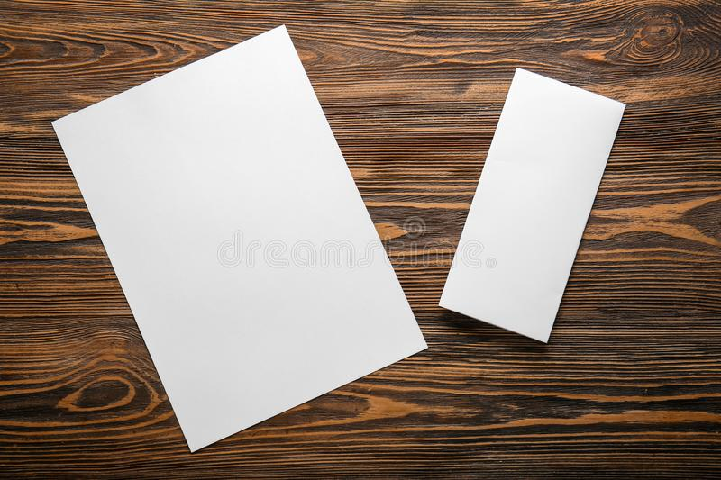 Empty sheets of paper on wooden table stock photos