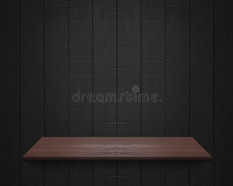 Empty shelf at black wooden wall background stock photo