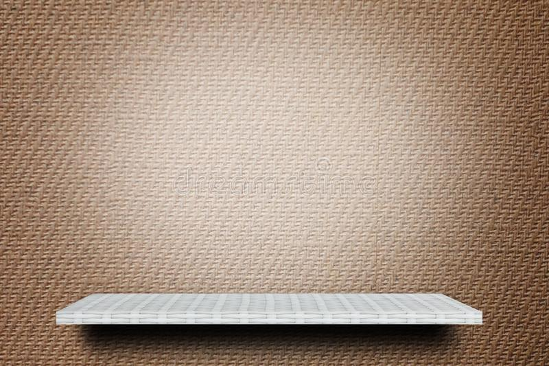 Empty shelf on brown background for advertising backdrop royalty free stock photo