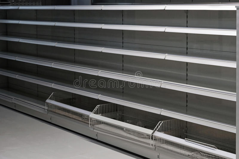 Empty shelf in grocery store stock photos