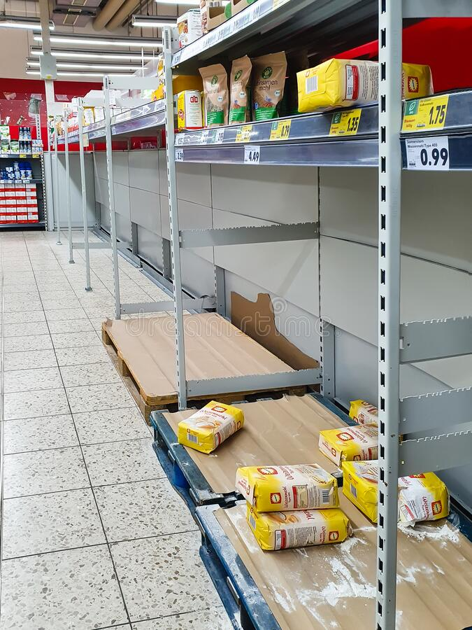 Empty shelves for flour at a supermarket in Germany due to Coronavirus pandemy stock image