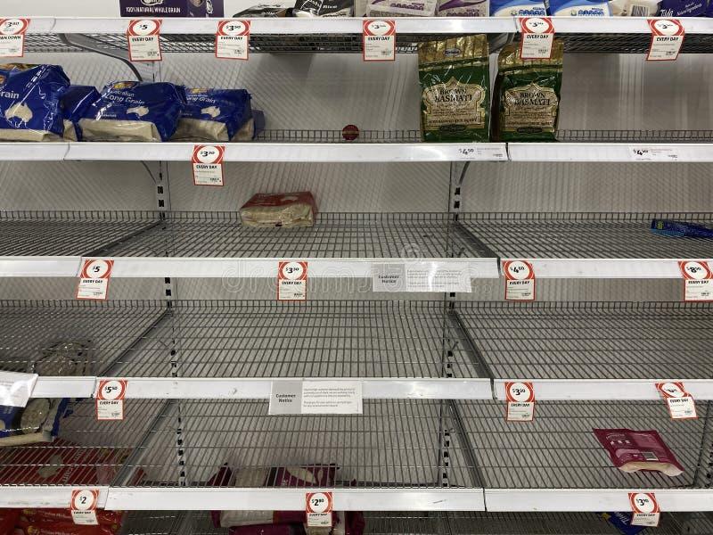 Empty shelves of rice in a supermarket due to corona virus. Narre Warren, Victoria Australia - March 6th 2020 -Empty rice shelves in a supermarket caused by stock image