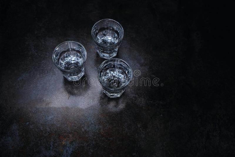 Empty shot glasses on bar counter, top view, copyspace stock image