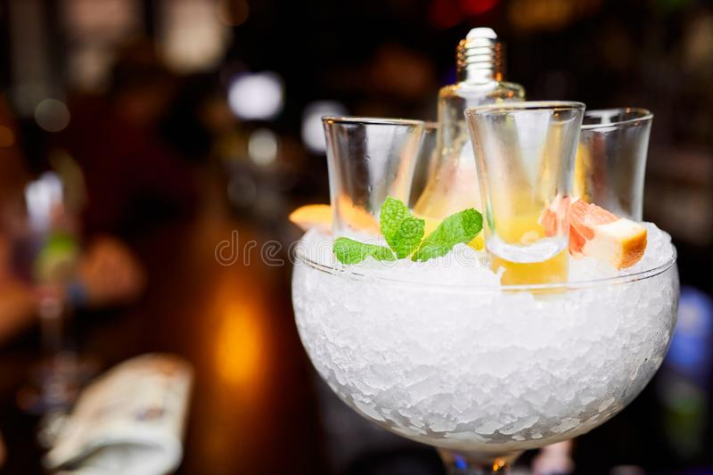 Empty shots in a glass with ice decorated with mint and grapefruit stock photos