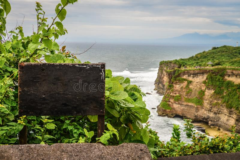 Empty signboard with cliff Uluwatu. On background, Bali, Indonesia. Amazing landscape - cliff with blue sky and sea stock photos