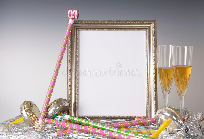 Empty Silver Frame Still Life for New Year's Eve with Champagne royalty free stock photography