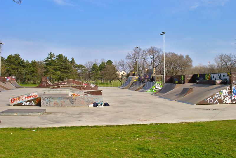 Empty Skate Park in Early Spring - All sorts of ramps stock image