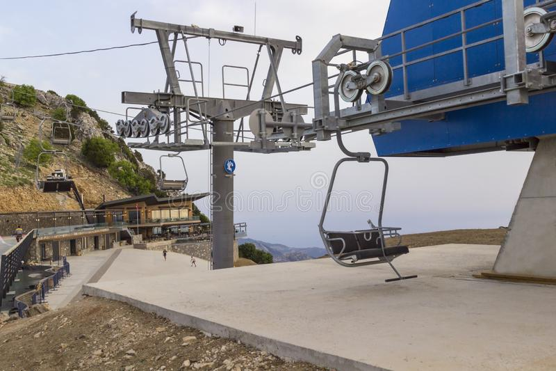 An empty ski lift on a sunny summer day. Mountain slopes.  stock photography