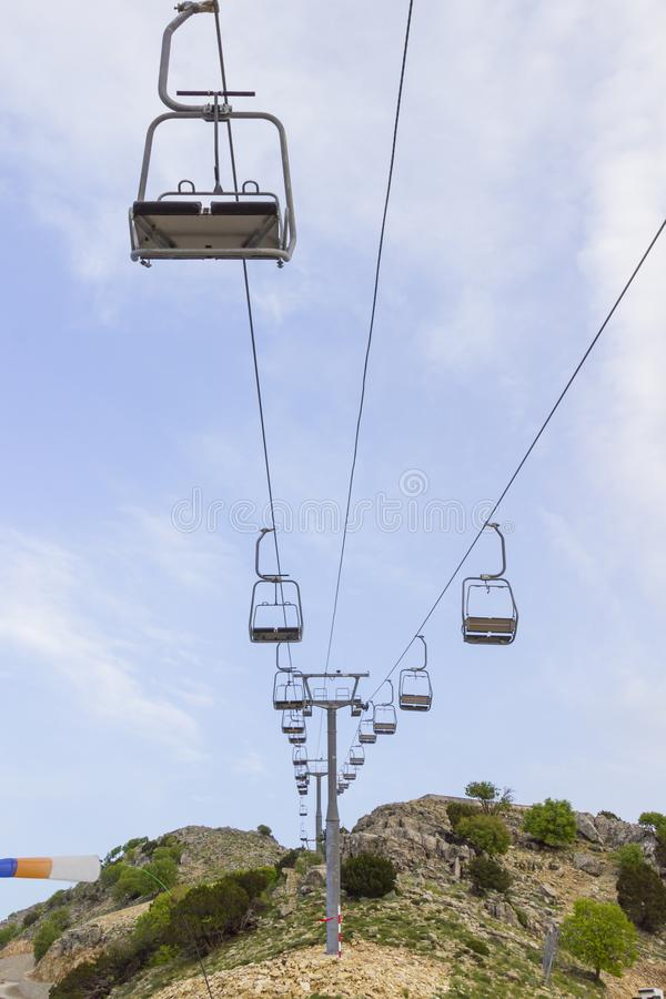 An empty ski lift on a sunny summer day. Mountain slopes.  royalty free stock photo
