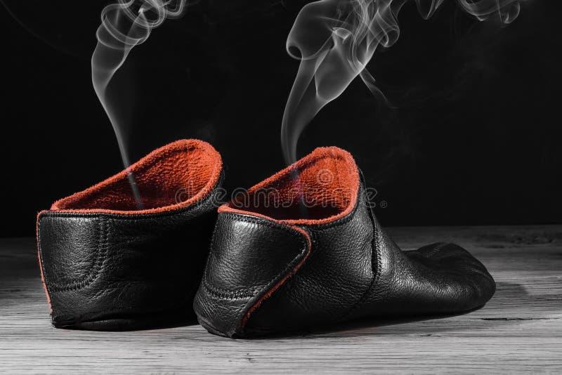Empty slipper shoe smoke rise stock photography