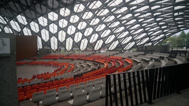 empty small arena orange chair and silver chair royalty free stock photos