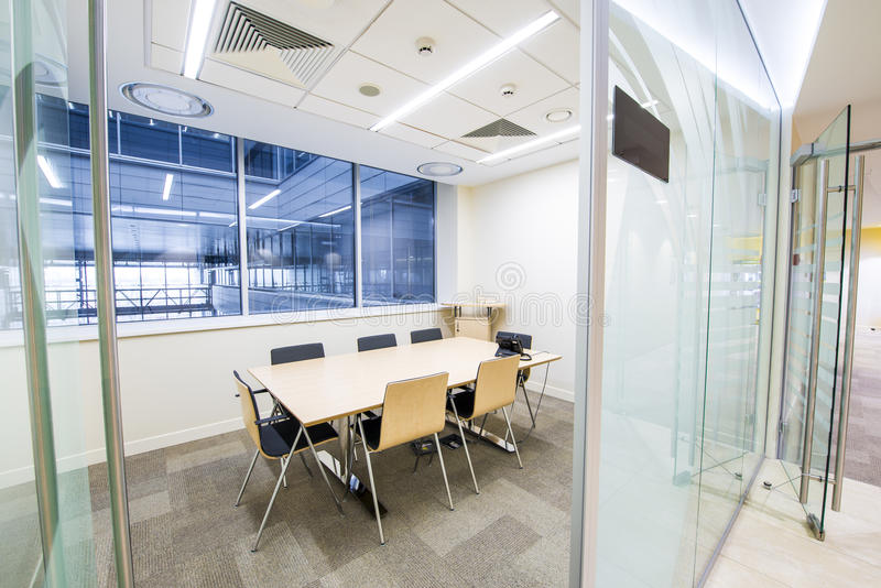 Empty small meeting room. Bright modern interior royalty free stock photo
