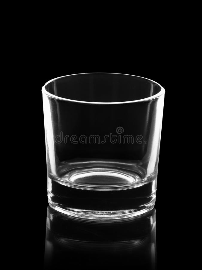 Empty small shot glass isolated on black. Background royalty free stock photos