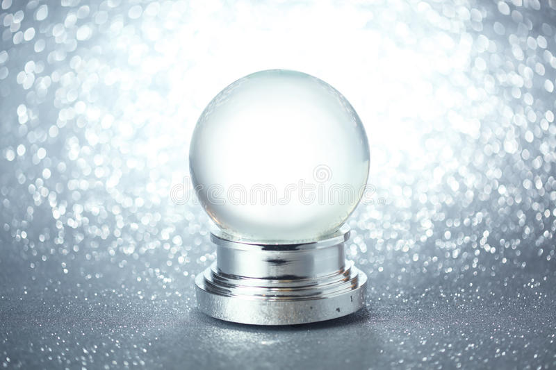 Empty snow globe. On glittering background royalty free stock photo