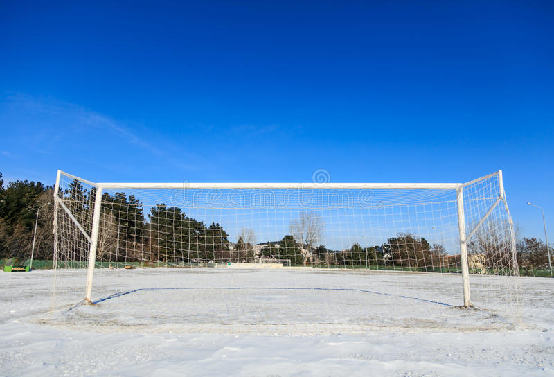 Empty snowy soccerball field. Empty soccerball field covered with snow stock photos