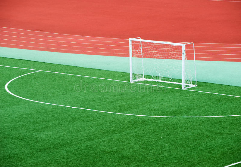 Empty soccer field. With goal posts and light poles stock image