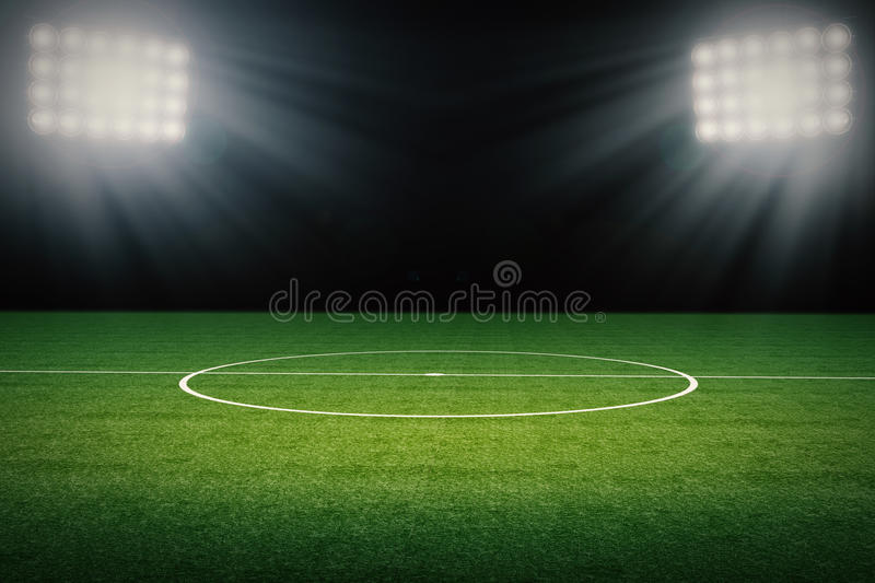 Empty soccer field. 3d rendering empty soccer field with stadium at night royalty free stock photo