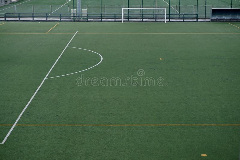 Empty soccer field. Green grass in the stadium royalty free stock photo
