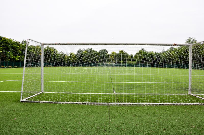 Empty soccer field. With Soccer net and goal stock photos
