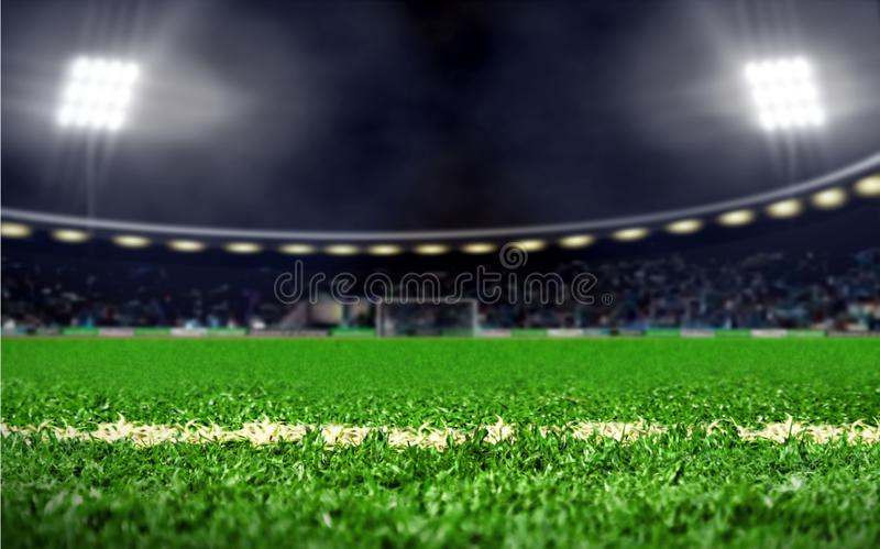Soccer field stadium with green grass and bright spotlights at night stock images