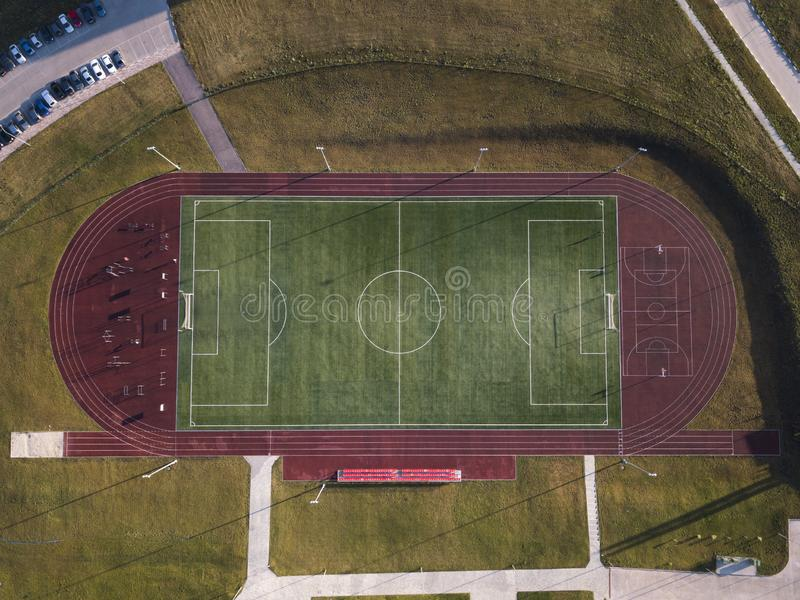 Empty soccer Stadium aerial drone top view green field stock photos