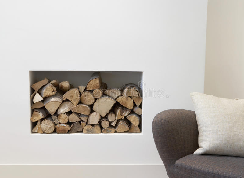 Empty Sofa with fire place behind stock photography