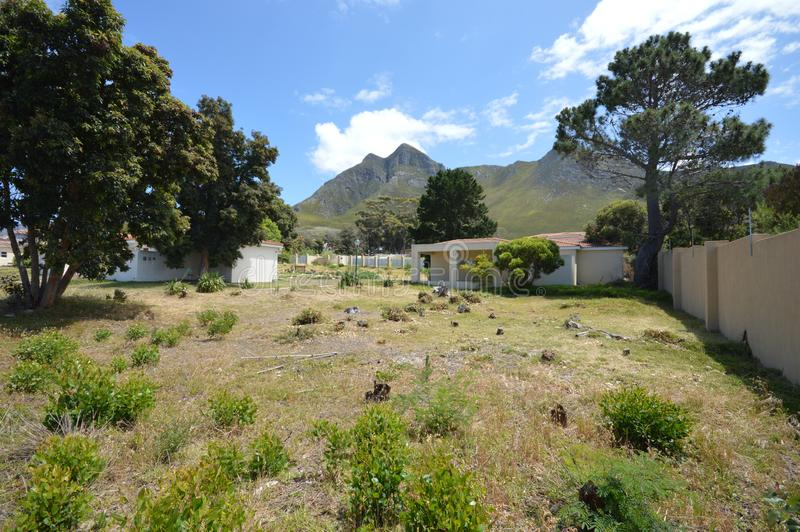 Empty space in a private complex. Empty land with distant mountain views on a sunny day with blue skies and clouds stock photo