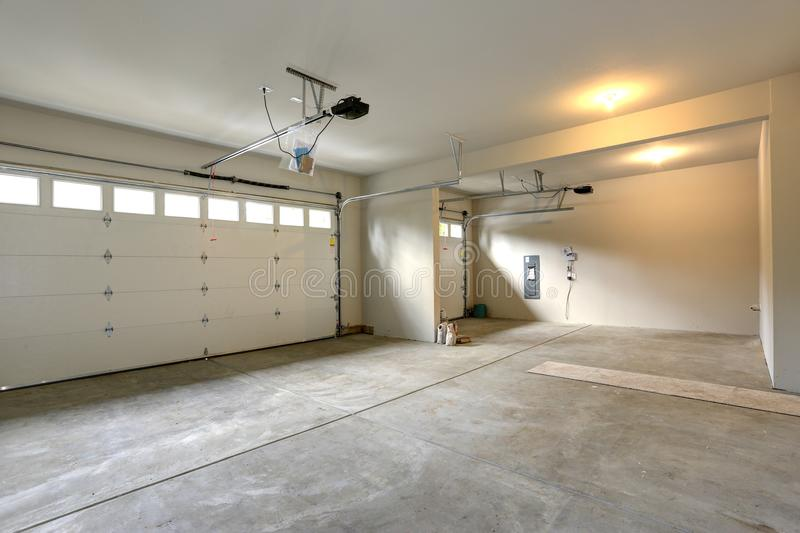 Empty spacious garage interior. With cream walls paint color and concrete floor royalty free stock photography