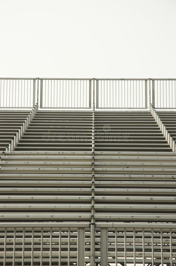 Empty stadium bleachers stock images