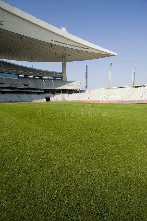 Empty Stadium and The Field. Empty Olympic Stadium and soccer field stock photo