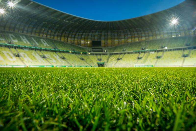 Empty stadium, with open roof. Close up on grass stock photos