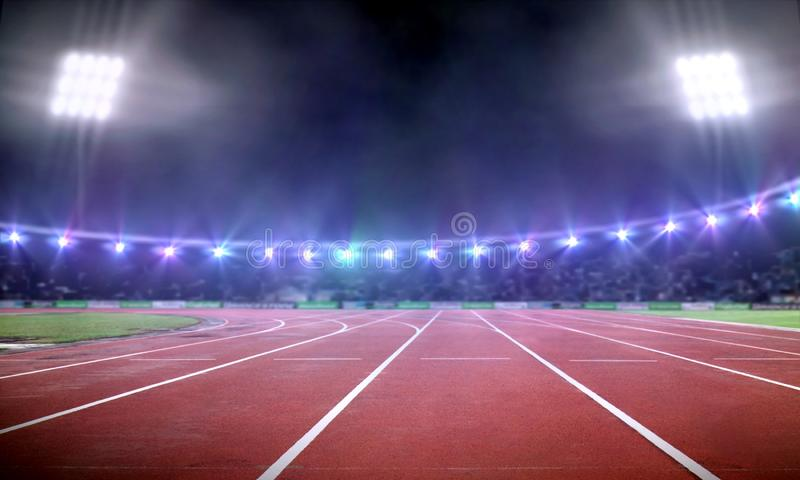 Empty stadium with running track at night stock image