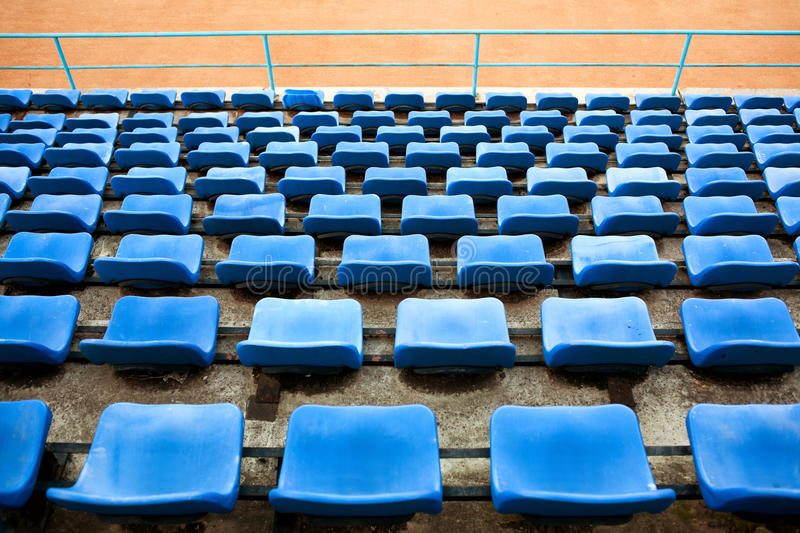 Empty stadium seats stock photo