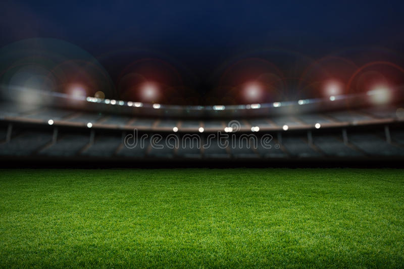 Empty stadium with soccer field. At night royalty free stock photo