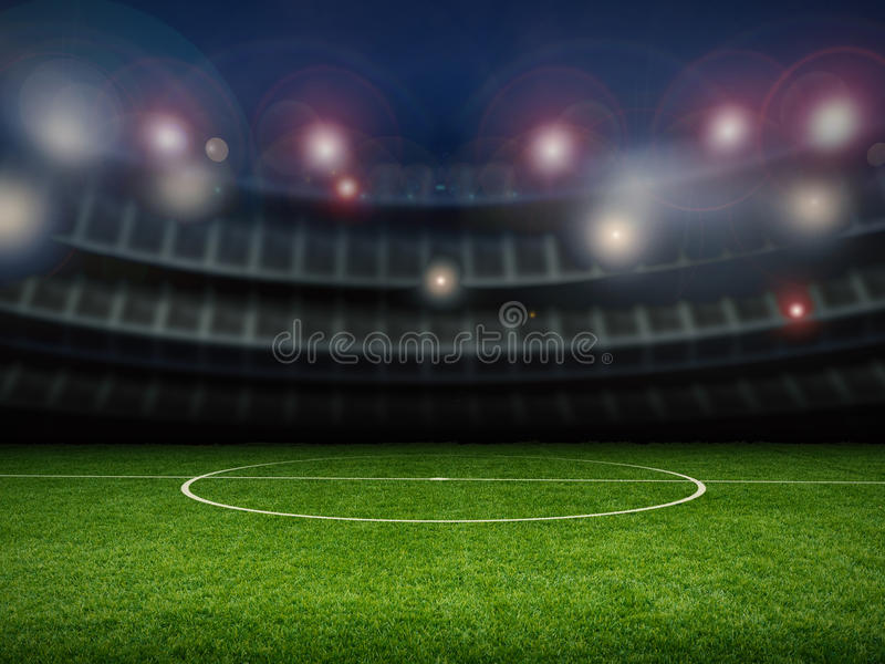 Empty stadium with soccer field. At night stock image