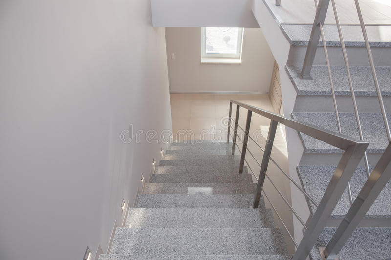 Empty staircase in detached house. Horizontal view of empty staircase in detached house royalty free stock photography
