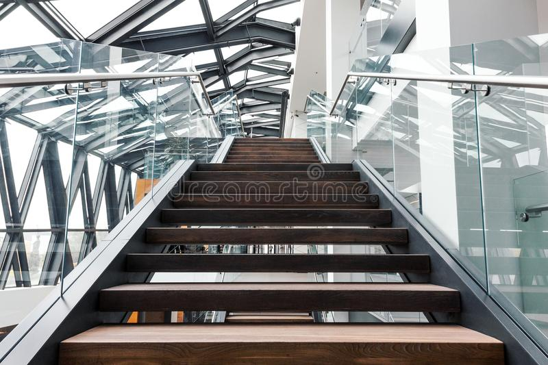 Empty stairs in modern office building interior stock images