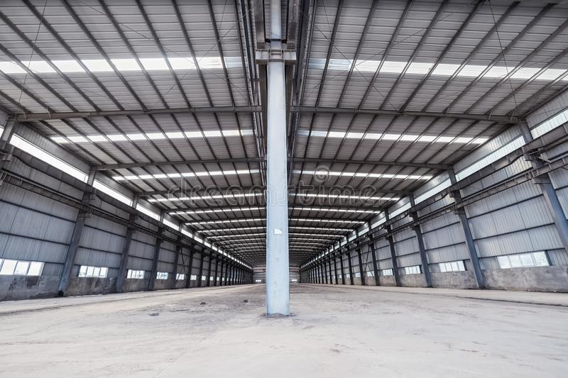 Empty steel structure warehouse. Abandoned factory buildings or workshop background royalty free stock images