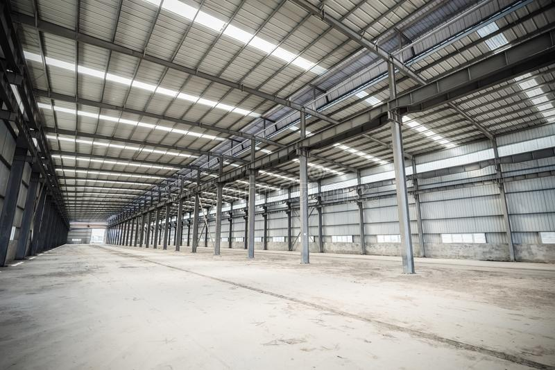 Empty steel structure workshop. Abandoned factory buildings or warehouse background stock photos