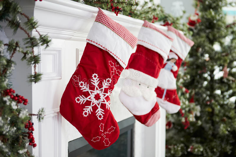 Empty Stockings Hung On Fireplace On Christmas Eve stock photo