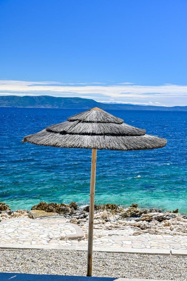 Empty stone beach with sunshades in Rabac Croatia. May 2019 royalty free stock photography