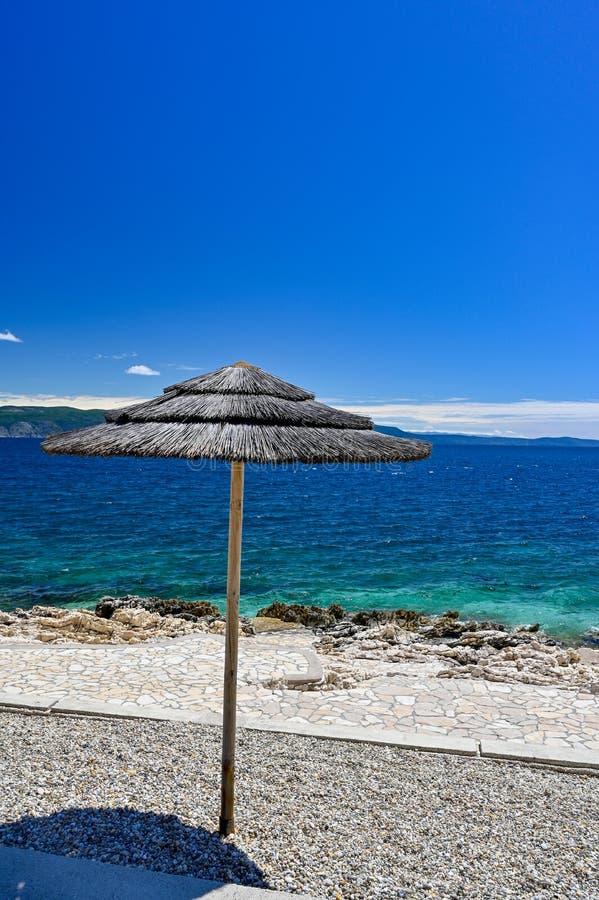 Empty stone beach with sunshades in Rabac Croatia. May 2019 royalty free stock photo