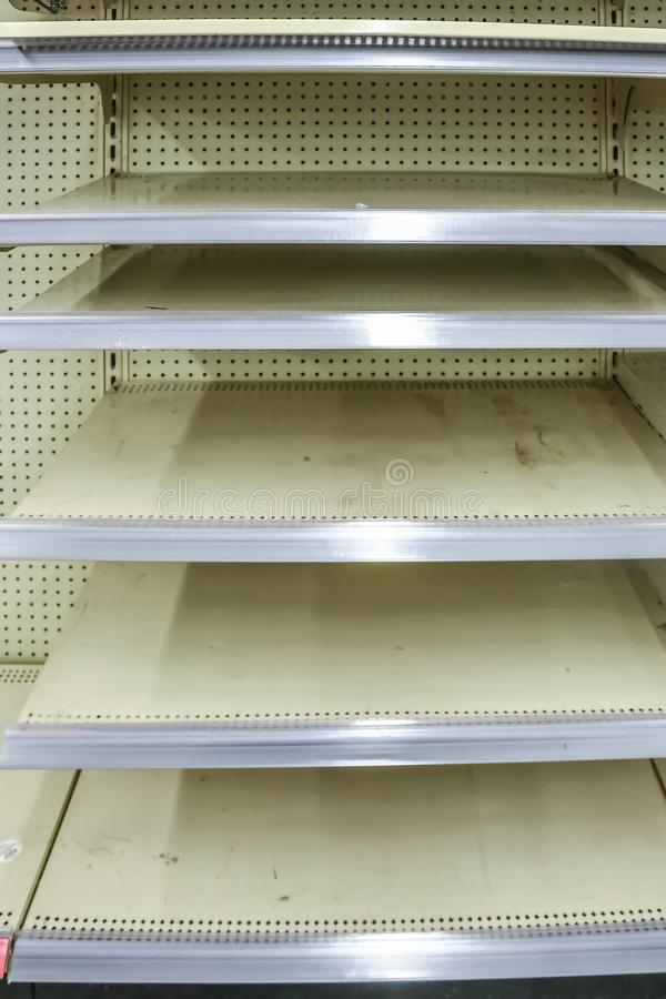 Empty store metal shelves after seasonal goods are sold out waiting for new merchandise.  stock images