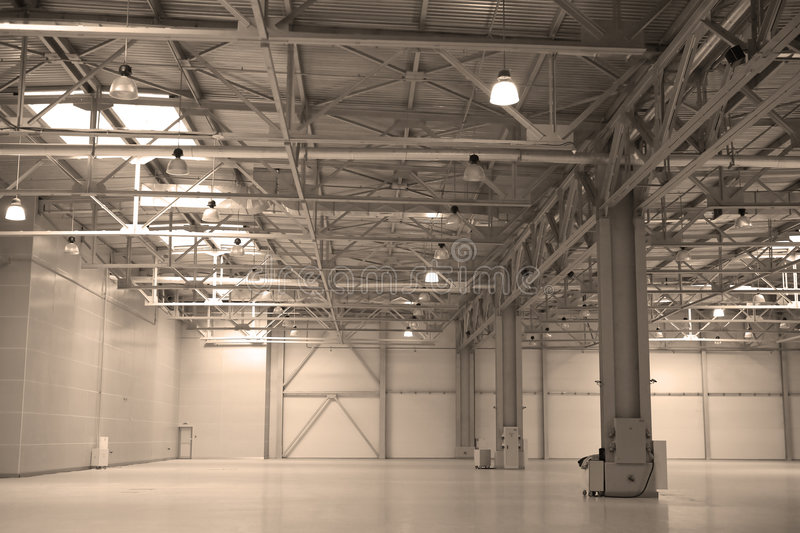Empty storehouse. Some modern empty building interior stock photography