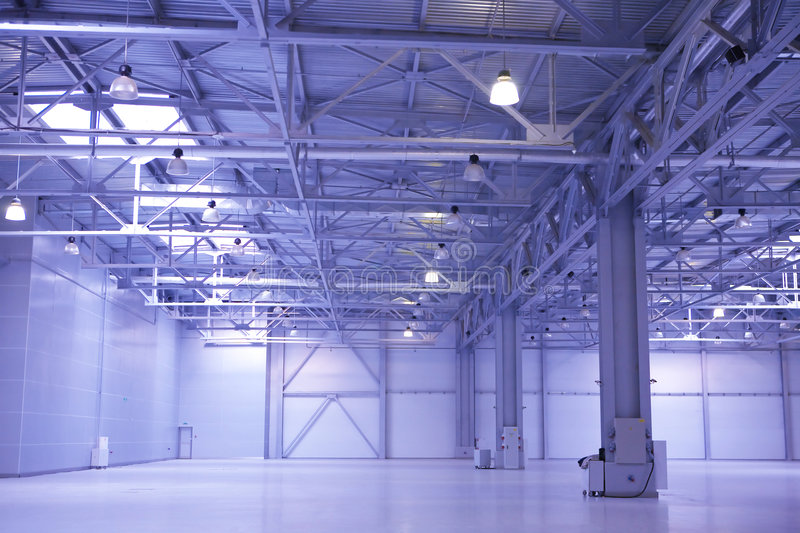 Empty storehouse. Some large modern empty storehouse stock photography
