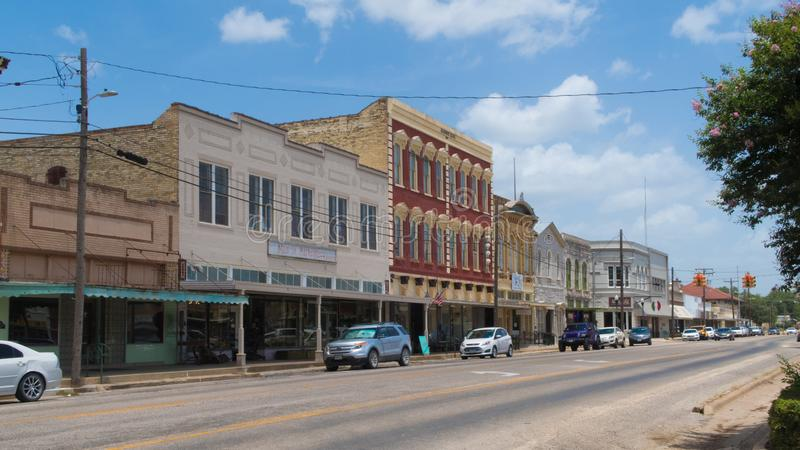 Empty stores lining the street in a small Texas town. GONZALES, TEXAS - JUNE 10 2018: small town Texas with mostly empty stores stock photography