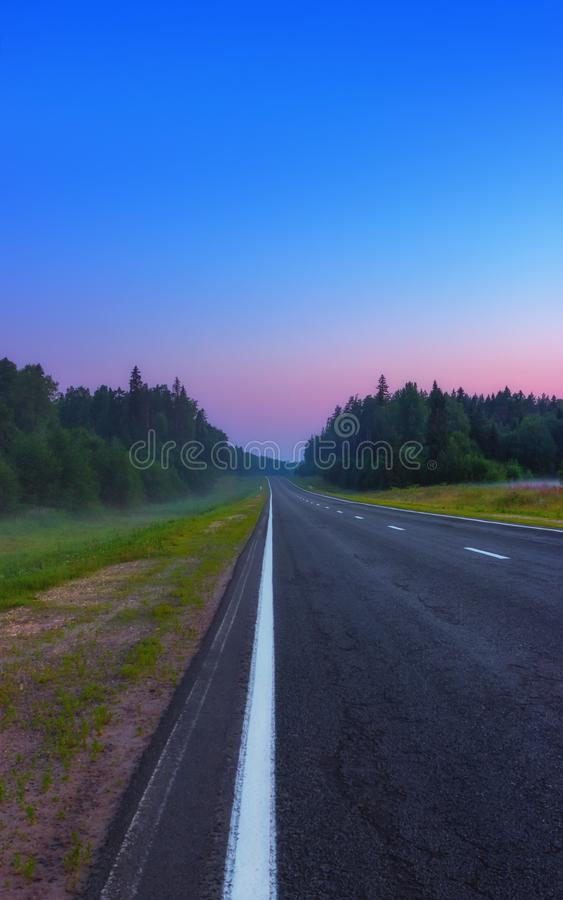 Empty Asphalt Road In The Twilight At Dawn stock photography
