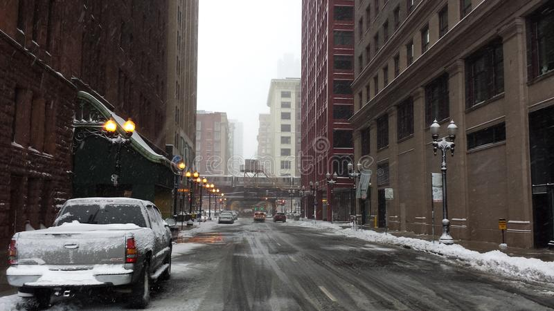 Empty street amid snow storm in Chicago stock image